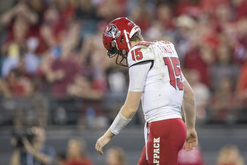 North Carolina State quarterback Ryan Finley (15) reacts after throwing an incomplete pass on third down down during the first half against Texas A&M in the Gator Bowl NCAA college football game Monday, Dec. (James Gilbert/The Florida Times-Union via AP)