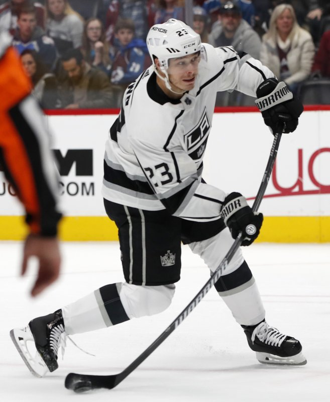 Los Angeles Kings right wing Dustin Brown shoots the winning goal in overtime of an NHL hockey game against the Colorado Avalanche on Monday, Dec. (AP Photo/David Zalubowski)