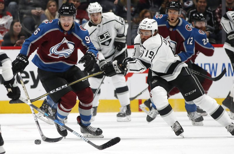 Los Angeles Kings left wing Alex Iafallo, right, fights for control of the puck with Colorado Avalanche right wing Mikko Rantanen during the first period of an NHL hockey game Monday, Dec. (AP Photo/David Zalubowski)