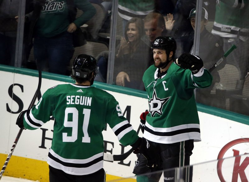 Dallas Stars left wing Jamie Benn, right, celebrates his goal with Stars center Tyler Seguin (91) against the Montreal Canadiens during the second period of an NHL hockey game in Dallas, Monday, Dec. (AP Photo/Michael Ainsworth)