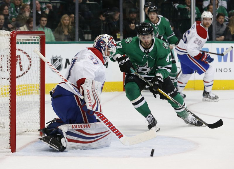 Montreal Canadiens goaltender Antti Niemi (37) makes a save as Dallas Stars right wing Alexander Radulov (47) watches the rebound during the first period of an NHL hockey game in Dallas, Monday, Dec. (AP Photo/Michael Ainsworth)