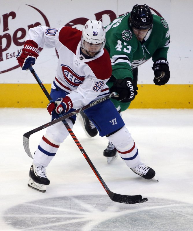 Dallas Stars right wing Valeri Nichushkin (43) defends against Montreal Canadiens left wing Tomas Tatar (90) during the second period of an NHL hockey game in Dallas, Monday, Dec. (AP Photo/Michael Ainsworth)