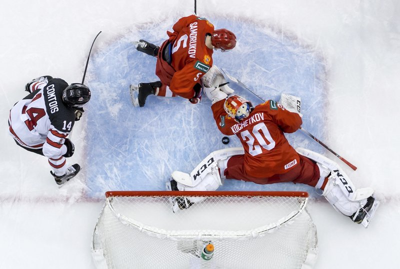 Russia goalie Pyotr Kochetkov (20) makes a save as Dmitri Samorukov (5) and Canada's Maxime Comtois (14) watch during the second period of a world junior hockey championships game in Vancouver, British Columbia, Monday, Dec. (Darryl Dyck/The Canadian Press via AP)