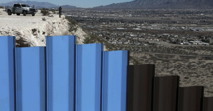 An agent from the border patrol, observes near the Mexico-US border fence, on the Mexican side, separating the towns of Anapra, Mexico and Sunland Park, N.M. An 8-year-old boy from Guatemala died in government custody early Tuesday, Dec. 25, 2018, U.S. immigration authorities said. (AP Photo/Christian Torres, File)
