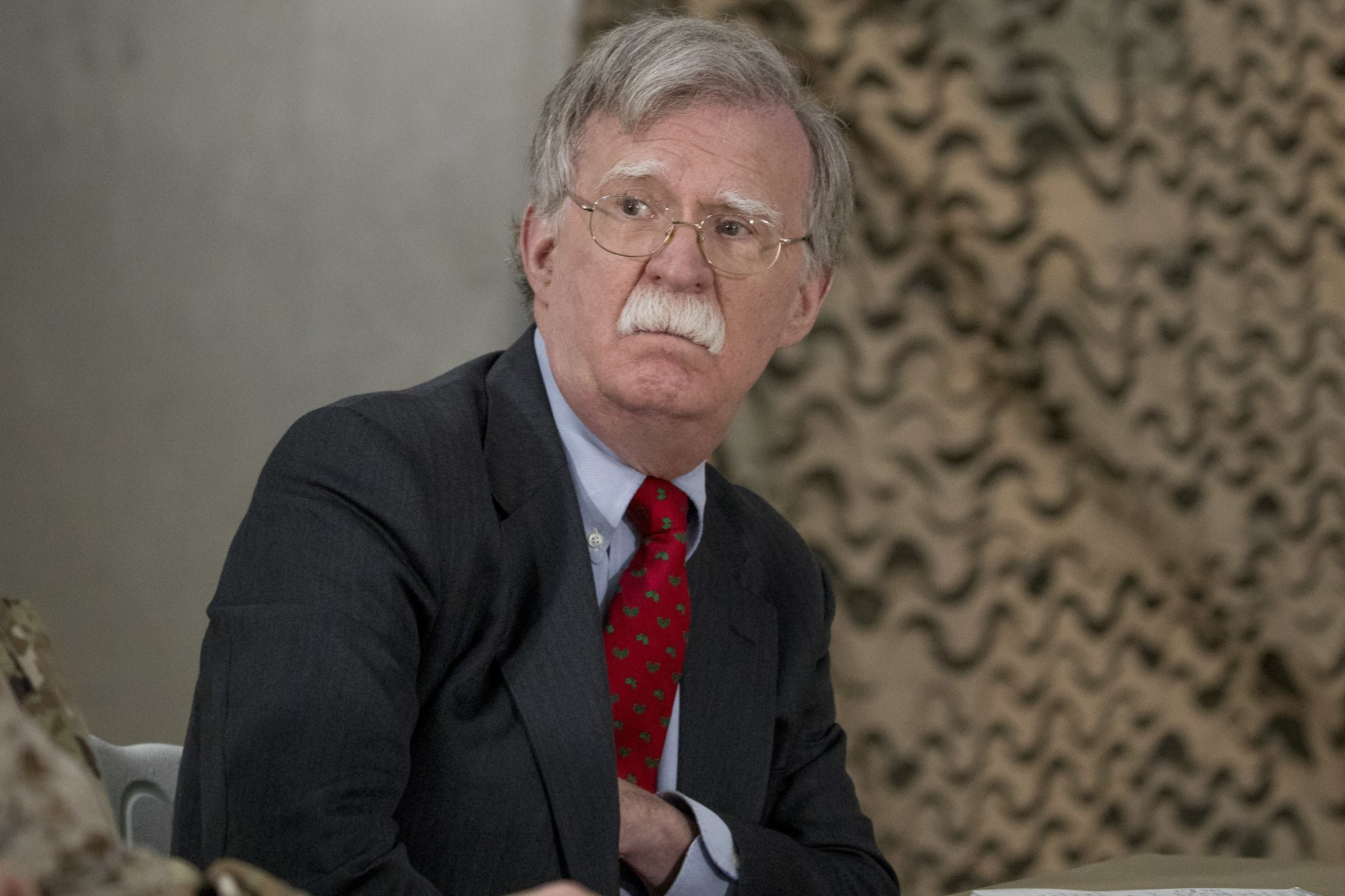 National Security Adviser John Bolton attends a meeting with President Donald Trump and senior military leadership at Al Asad Air Base, Iraq, Wednesday, Dec. 26, 2018. President Donald Trump made an unannounced trip to Iraq on Wednesday to meet U.S. troops. It's the sixth time that a U.S. president has visited Iraq. (AP Photo/Andrew Harnik)