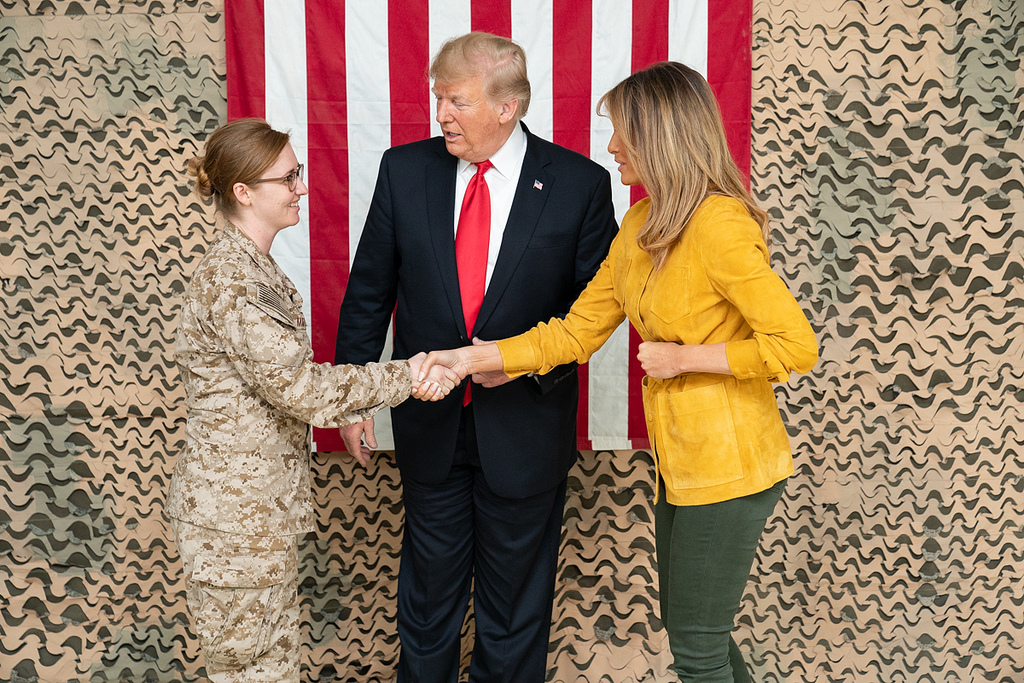 President Donald J. Trump, joined by First Lady Melania Trump, shakes hands and speaks with U.S. military personnel Wednesday, December 26, 2018, at the Al-Asad Airbase in Iraq. (Official White House Photo by Shealah Craighead)