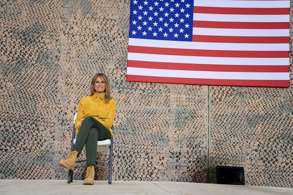 First Lady Melania Trump sits on stage as President Donald J. Trump addresses his remarks to U.S. troops Wednesday, December 26, 2018, at the Al-Asad Airbase in Iraq. (Official White House Photo by Shealah Craighead)