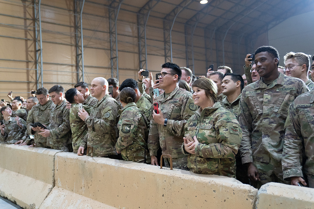 U.S. troops listen as President Donald J. Trump, joined by First Lady Melania Trump, addresses his remarks to U.S. troops Wednesday, December 26, 2018, at the Al-Asad Airbase in Iraq. (Official White House Photo by Shealah Craighead)