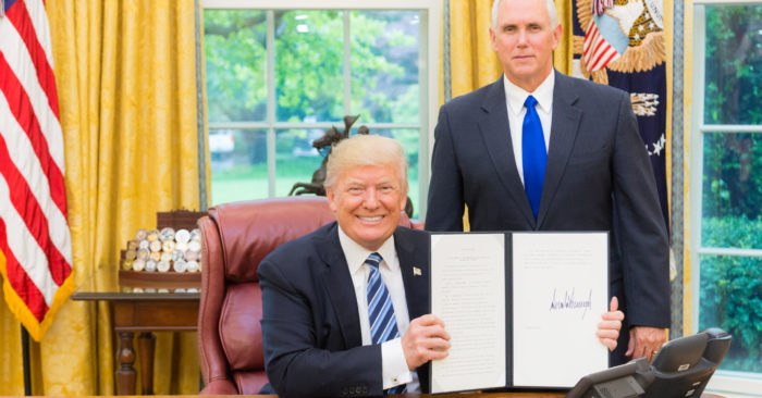 President Donald J. Trump, joined by Vice President Mike Pence, displays his signed Executive Order for the Establishment of a Presidential Advisory Commission on Election Integrity, Thursday, May 11, 2017, in the Oval Office of the White House in Washington, D.C. (Official White House Photo by Shealah Craighead).
