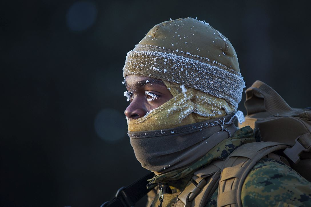 Marine Corps Lance Cpl. Kwan Walker faces the cold during a conditioning hike as part of exercise Ullr Shield at Fort McCoy, Wis., Jan. 13, 2018. The training aims to improve Marine capabilities in extreme cold weather environments. Walker is a networking administrator assigned to Marine Wing Communication Squadron 28.