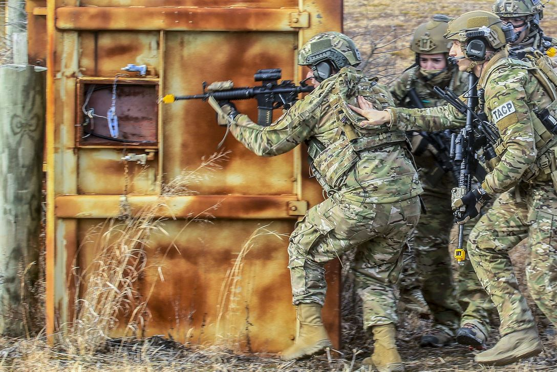 Airmen move tactically to a target building during training at Warren Grove Gunnery Range, N.J., Feb. 9, 2018. The airmen are assigned to the New Jersey Air National Guard's 227th Air Support Operations Squadron.