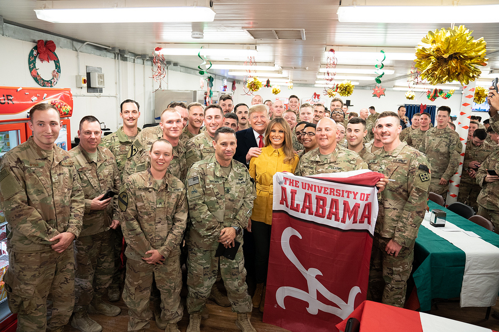 President Donald J. Trump and First Lady Melania Trump pose for a group photo with U.S. troops Wednesday, December 26, 2018, during their visit to the Al-Asad Airbase in Iraq. (Official White House Photo by Shealah Craighead)