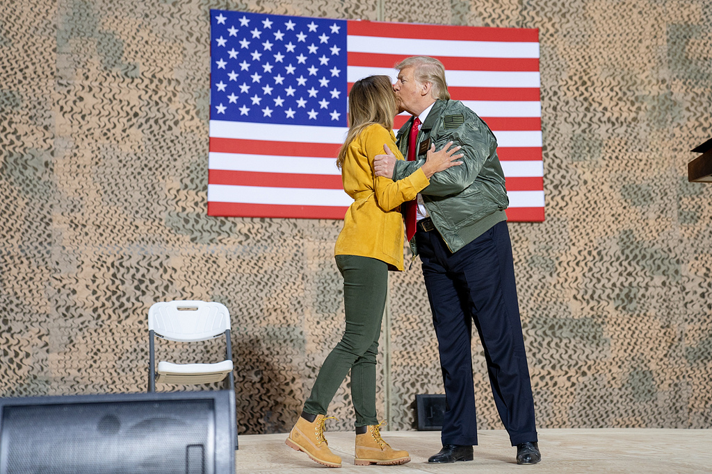President Donald J. Trump gives First Lady Melania Trump a kiss after her address to U.S. troops Wednesday, December 26, 2018, at the Al-Asad Airbase in Iraq. (Official White House Photo by Shealah Craighead)