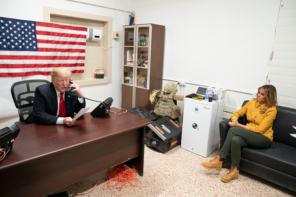 President Donald J. Trump, joined by First Lady Melania Trump, speaks on the phone with Iraq Prime Minister Adil Abdul-Mahdi Wednesday, December 26, 2018, during his visit to Al-Asad Airbase in Iraq. (Official White House Photo by Shealah Craighead)