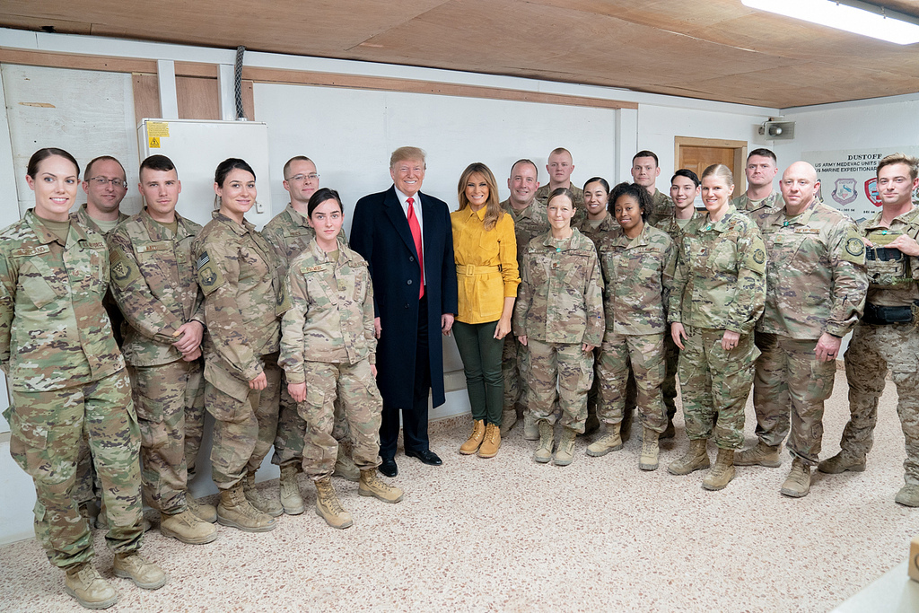 President Donald J. Trump and First Lady Melania Trump pose for a photo with U.S. Pararescue personnel Wednesday, December 26, 2018, at the Al-Asad Airbase in Iraq. (Official White House Photo by Shealah Craighead)