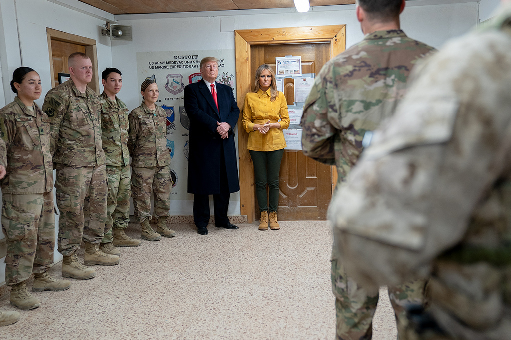President Donald J. Trump and First Lady Melania Trump participate in a demonstration by U.S. Pararescue personnel Wednesday, December 26, 2018, of military equipment and field kits at the Al-Asad Airbase in Iraq. (Official White House Photo by Shealah Craighead)