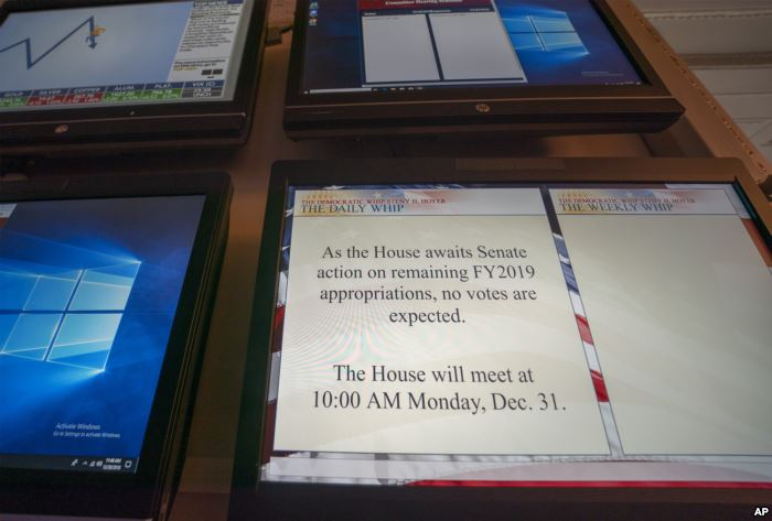 A monitor in the House of Representatives displays a schedule update on Capit