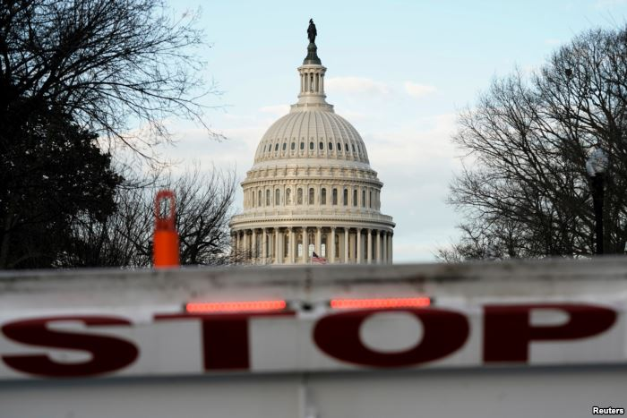 A security barricade is placed in front of the US Capitol on the first day of
