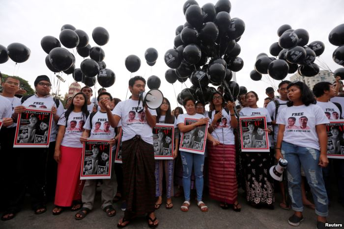 Activists gather at a rally, calling for the release of imprisoned Reuters jo