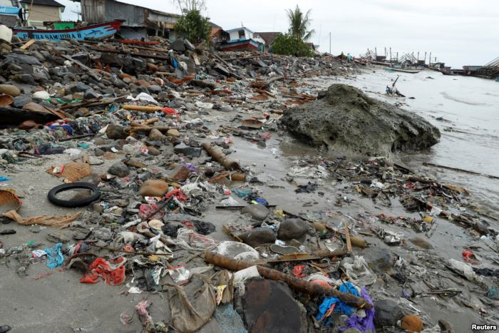 Debris and damaged property is seen after a tsunami, in Sumur, Banten provinc