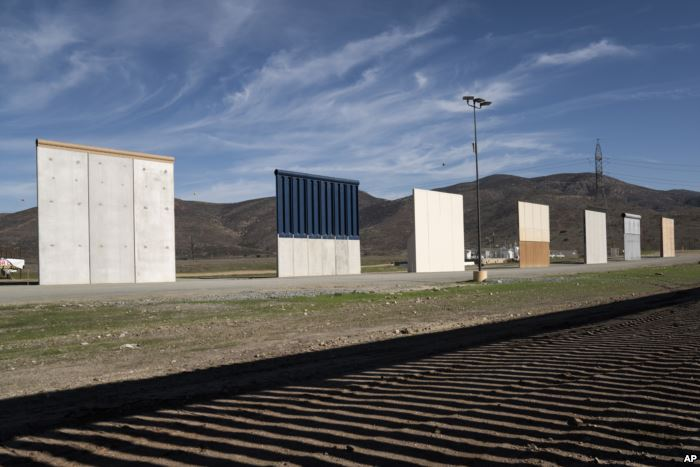 FILE - Border wall prototypes stand in San Diego near the U.S.-Mexico border,
