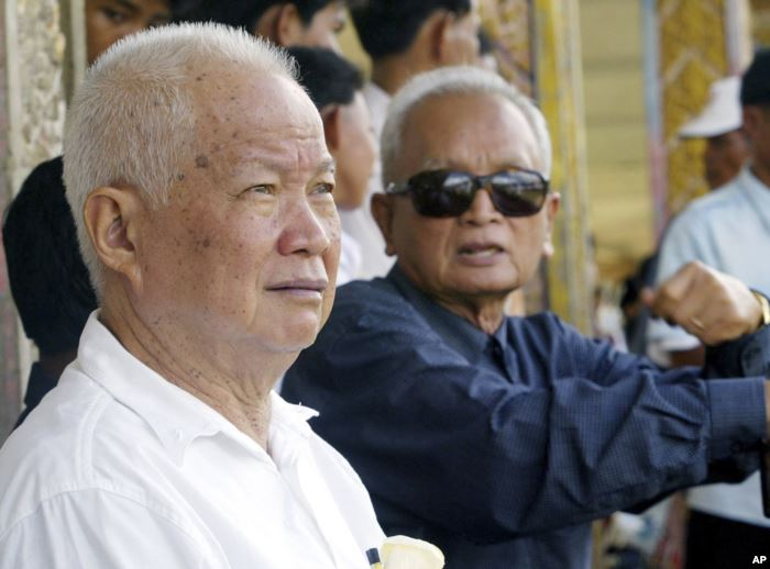 FILE - Former Khmer Rouge leaders Khieu Samphan, left, and Nuon Chea sit toge