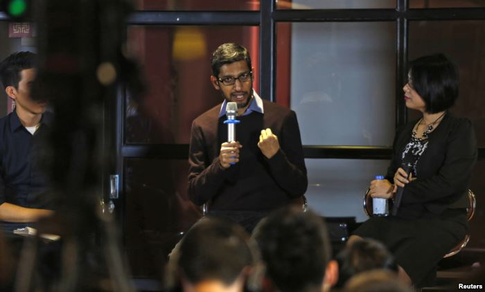 FILE - Google CEO Sundar Pichai gestures as he addresses conference with loca