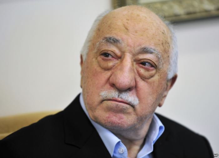FILE -Islamic cleric Fethullah Gulen speaks to members of the media at his co