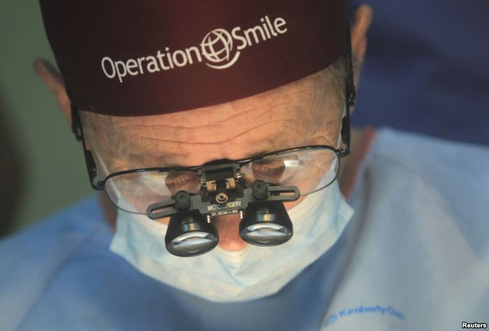 FILE - Operation Smile co-founder Bill Magee performs a facial deformity repa