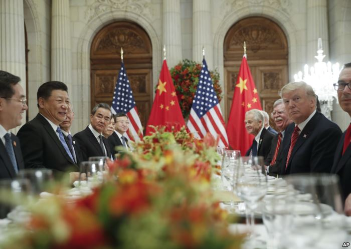 FILE - President Donald Trump and China's President Xi Jinping lead their