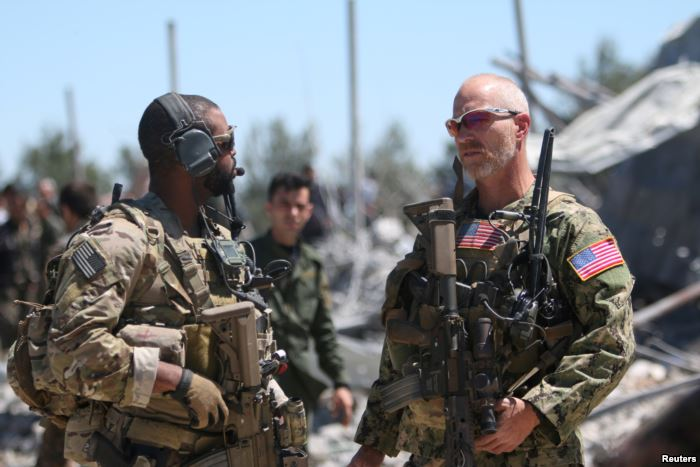 FILE - U.S. forces are seen at the Kurdish People's Protection Units (YPG