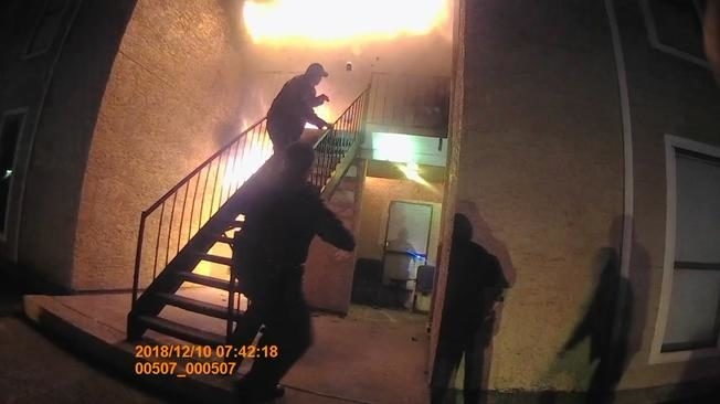 Body camera video shows the moment when Texas police officers saved a boy from an apartment on fire. The officers caught the boy as he jumped from the burning unit in Balch Springs, near Dallas. (Dec. 12)