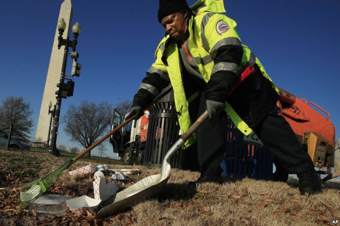 Jimmy Taylor of the Department of Public Works collects trash at the National
