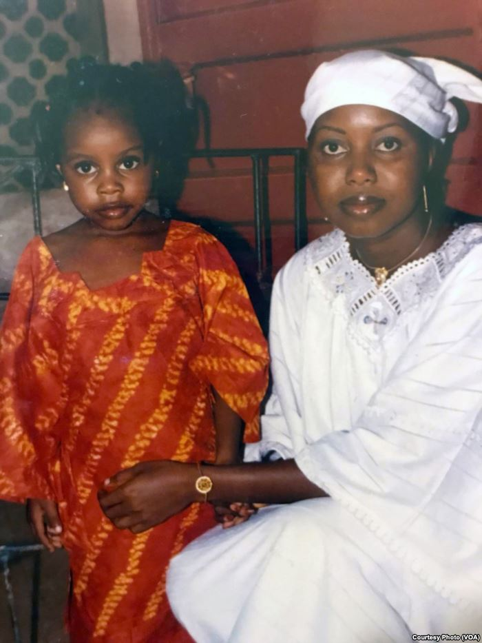 Maya Hughes, left, and Zainab Sesay pose during their time in Sierra Leone. A