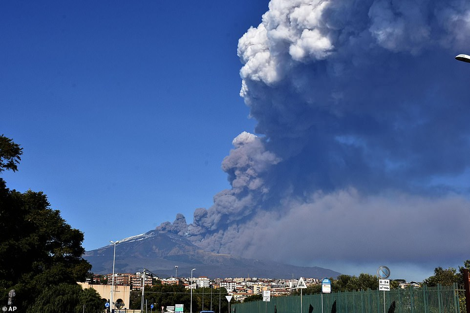 The Mount Etna observatory says lava and ash are spewing from a new fracture on the active Sicilian volcano amid an unusually high level of seismic activity