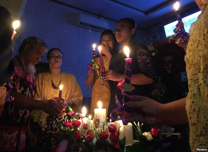 Residents affected by the tsunami attend a Mass during Christmas at Rahmat Ca