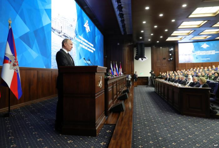 Russian President Vladimir Putin makes an address during a meeting in the Rus