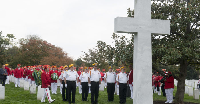 """Members of the United States Military Order of the Cootie, """"The Honor Degree of the Veterans of Foreign Wars,"""" place approximately 250 wreaths at the Argonne Cross in Section 18 of Arlington National Cemetery, Oct. 30, 2016. (U.S. Army photo by Rachel Larue/Arlington National Cemetery/released)"""