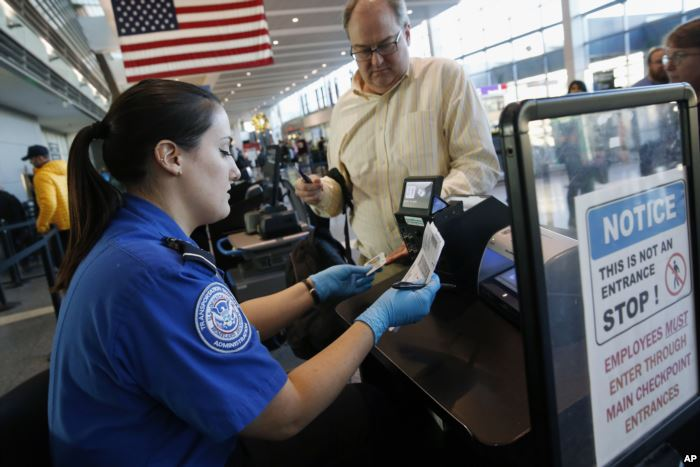 Transportation Security Administration officer Darby Finch checks boarding pa
