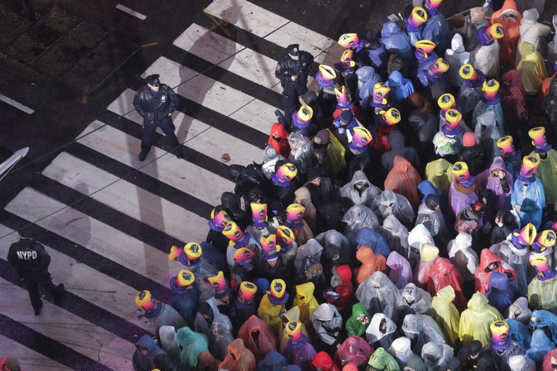 Revelers wait for midnight during the New Year's Eve celebration in New York's Times Square, as seen from above from the Marriott Marquis hotel, Monday, Dec. (AP Photo/Frank Franklin II)