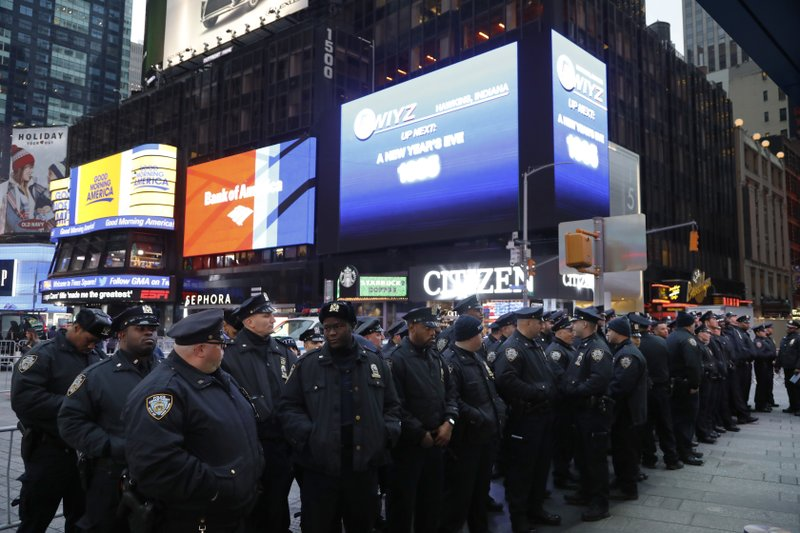 Police assemble in New York's Times Square before beginning to patrol, Monday, Dec. 31, 2018, in New York. (AP Photo/Mark Lennihan)