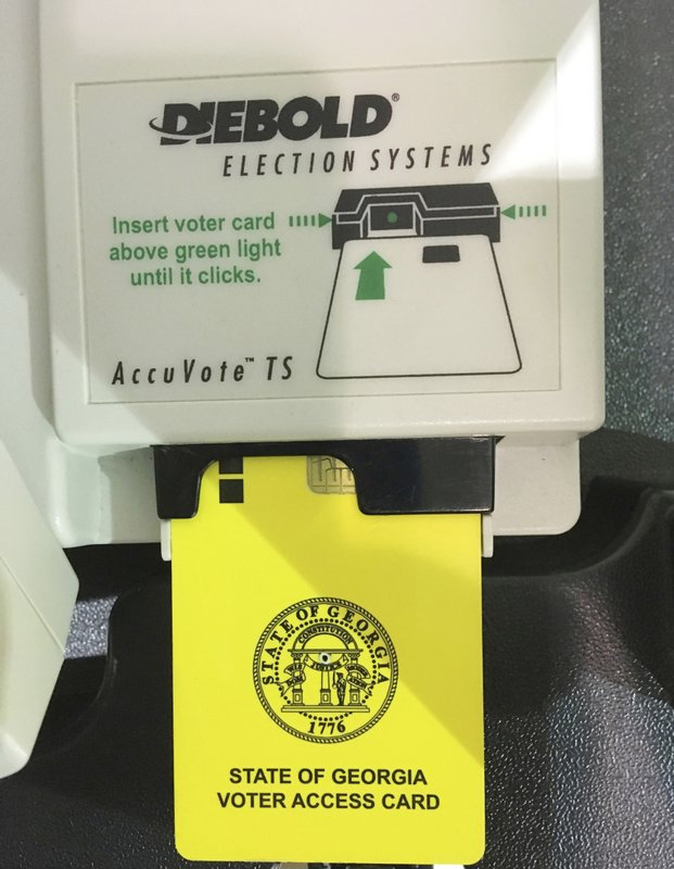 This May 22, 2018 photo shows a voter access card inserted in a voting reader during voting in the Georgia primary in Kennesaw, Ga. (AP Photo Mike Stewart)