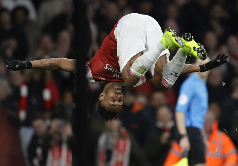 Arsenal's Pierre-Emerick Aubameyang celebrates after scoring his side's fourth goal during the English Premier League soccer match between Arsenal and Fulham at Emirates stadium in London, Tuesday, Jan. (AP Photo/Kirsty Wigglesworth)