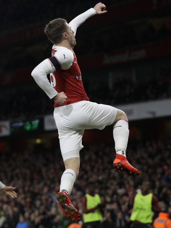 Arsenal's Aaron Ramsey celebrates after scoring his side's third goal during the English Premier League soccer match between Arsenal and Fulham at Emirates stadium in London, Tuesday, Jan. (AP Photo/Kirsty Wigglesworth)
