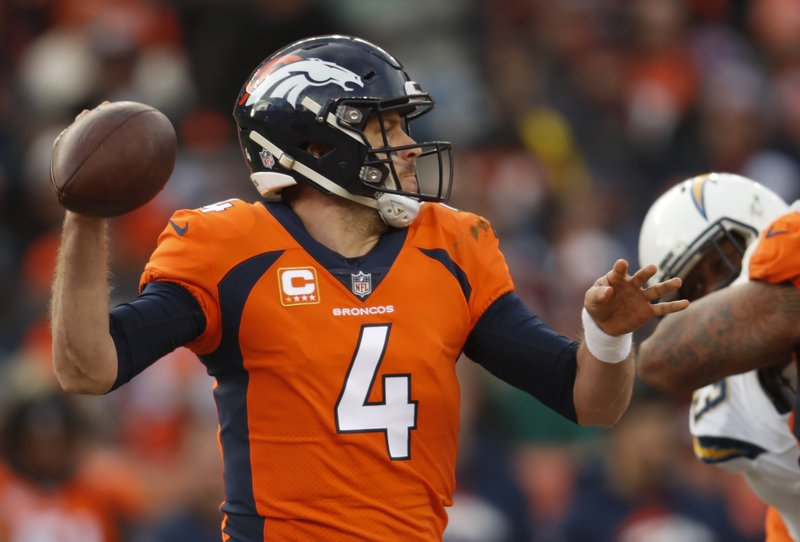 Denver Broncos quarterback Case Keenum throws a pass during the first half of an NFL football game against the Los Angeles Chargers, Sunday, Dec. (AP Photo/David Zalubowski)