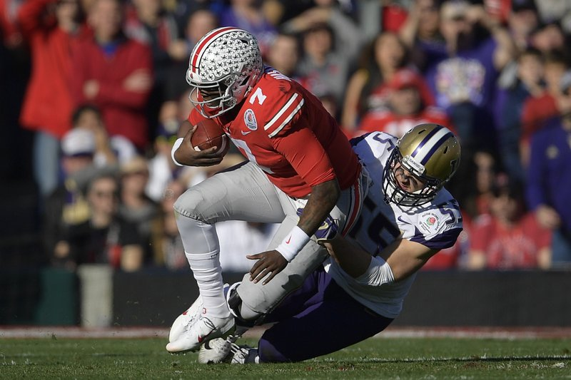 Ohio State quarterback Dwayne Haskins gets sacked by Washington linebacker Ryan Bowman during the first half of the Rose Bowl NCAA college football game Tuesday, Jan. (AP Photo/Mark J. Terrill)