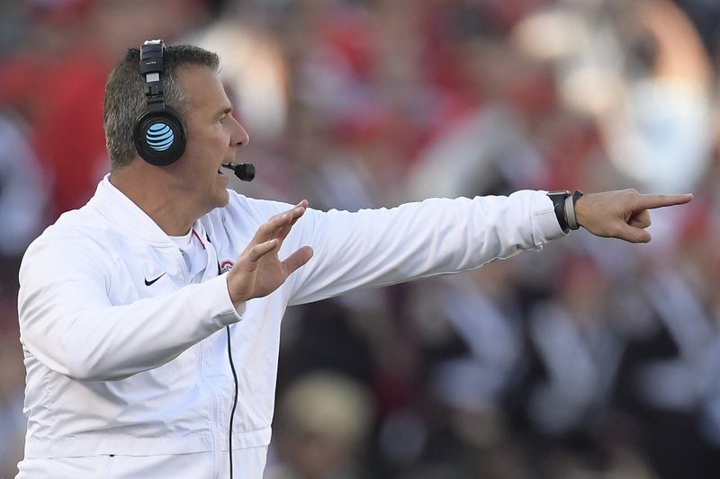 Ohio State coach Urban Meyer yells during the first half of the team's Rose Bowl NCAA college football game against Washington on Tuesday, Jan. (AP Photo/Mark J. Terrill)