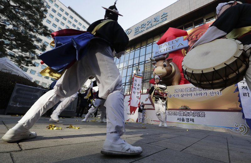 Dancers in traditional costumes perform to celebrate after the opening ceremony of the 2019 trading year at the Korea Exchange in Seoul, South Korea, Wednesday, Jan. (AP Photo/Lee Jin-man)