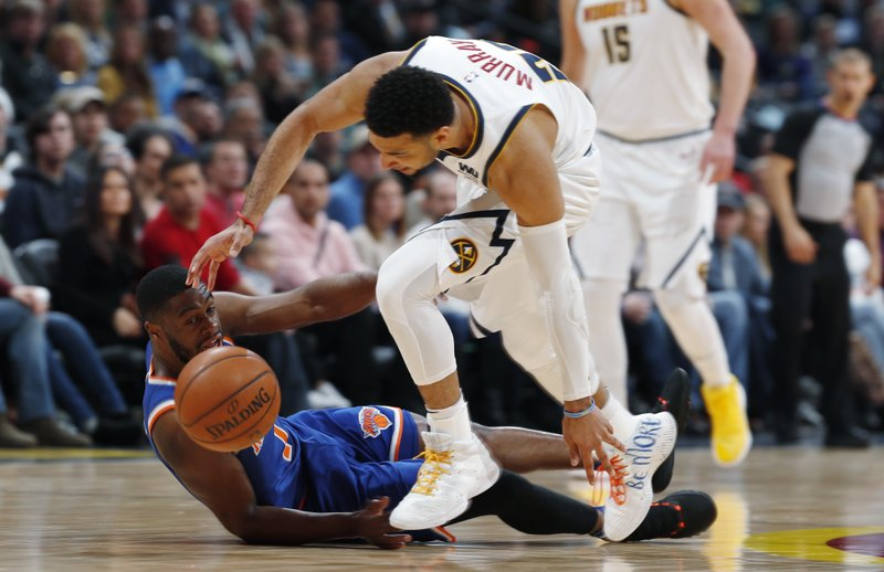 Denver Nuggets guard Jamal Murray, front, competes for the ball with New York Knicks guard Emmanuel Mudiay during the first half of an NBA basketball game Tuesday, Jan. (AP Photo/David Zalubowski)