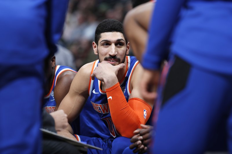 New York Knicks center Enes Kanter jokes with teammates during a timeout the first half of the team's NBA basketball game against the Denver Nuggets on Tuesday, Jan. (AP Photo/David Zalubowski)